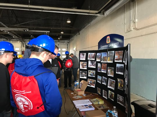 Students attending Wednesday's Construction and Technology Career Day peruse the display for the Carpenters Local #277.