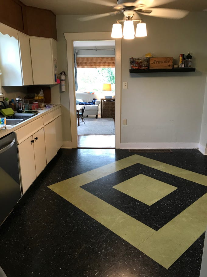 An old linoleum floor had layers of asbestos underneath, so removing it was not an option, given budget constraints.