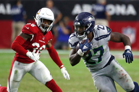 Mike Davis rushed for 101 yards and two touchdowns on Sunday against the Arizona Cardinals.