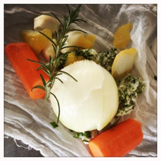 A piece of cheesecloth with onions, carrots and herbs will make a satchel to provide flavor to the soup.