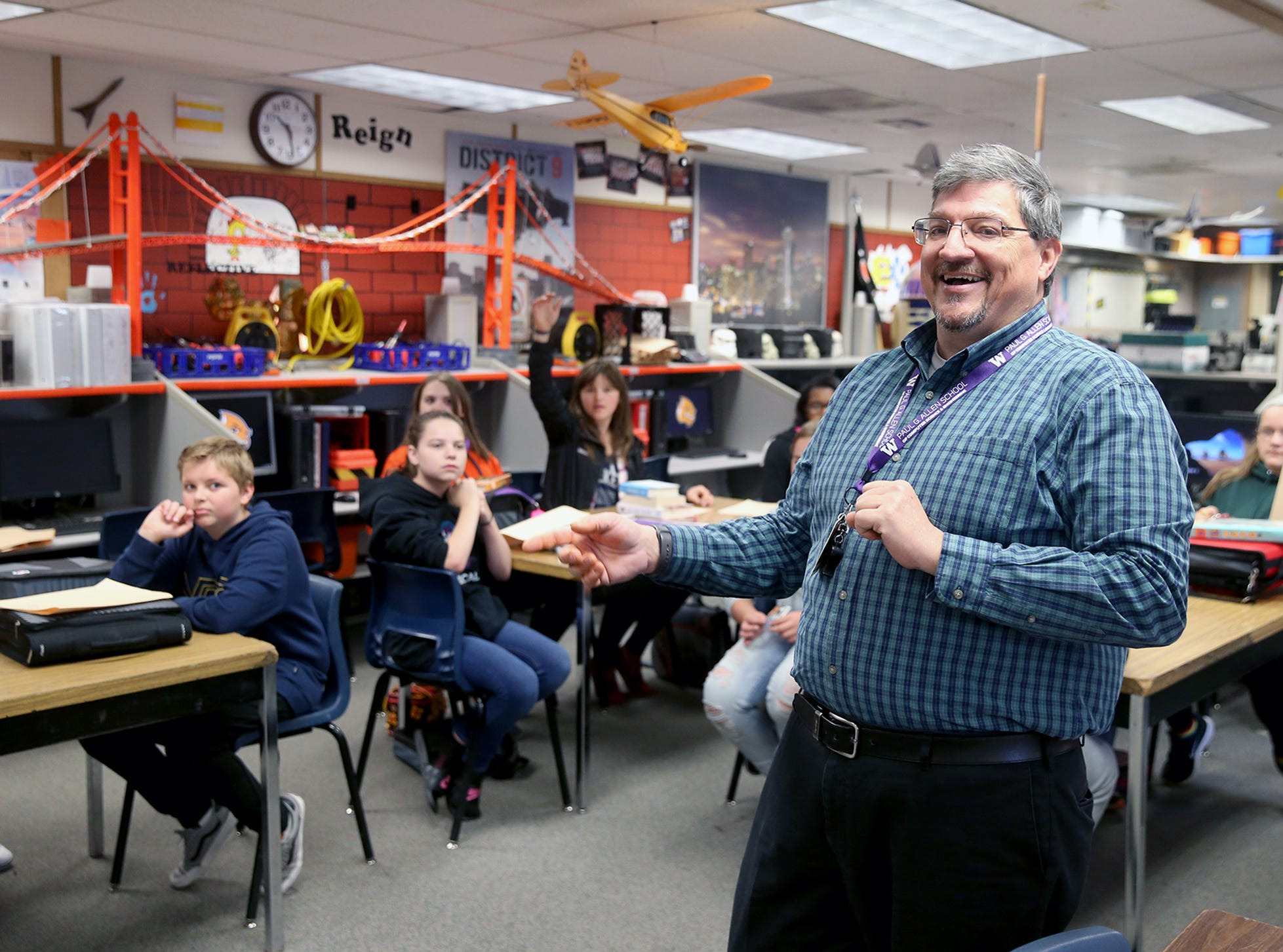 Will Lewis  Calls on students in his seventh grade yearbook class at Cedar Heights Middle School in Port Orchard.