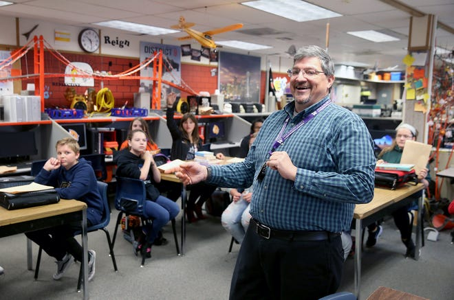 Cedar Heights Middle school teacher Will Lewis Calls on students in his seventh-grade yearbook class.
