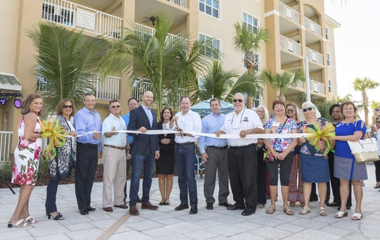 Cape Canaveral Mayor Bob Hoog (center with sunglasses) joins members of the the Orange Lake Resorts team to note the expansion of the Cocoa Beach Resort complex.