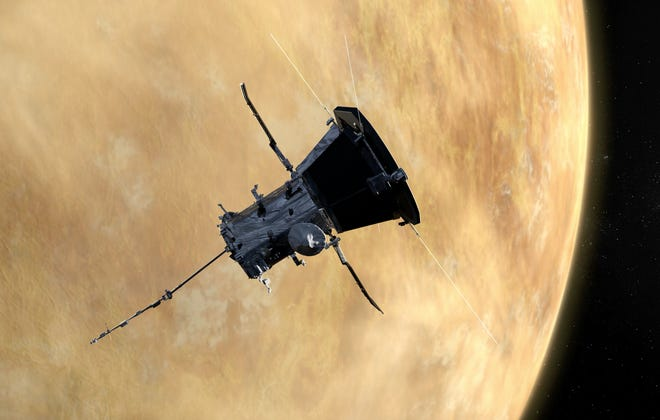 Artist concept of NASA's Parker Solar Probe flying past Venus.