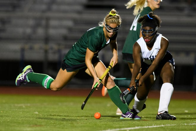 Rice's Lisa McNamara (2) battles for the ball with Burlington's Kava Hill (8) during the field hockey game between the Rice Green Knights and the Burlington Seahorses at Buck Hard Field on Friday night September 28, 2018 in Burlington.
