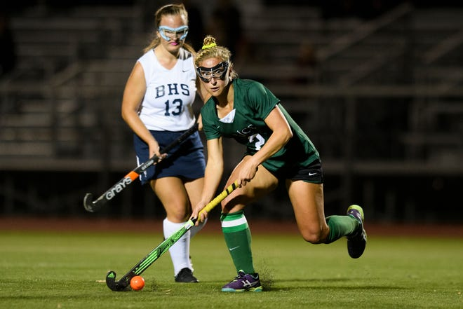 Rice's Lisa McNamara (2) looks to pass the ball during the field hockey game between the Rice Green Knights and the Burlington Seahorses at Buck Hard Field on Friday night September 28, 2018 in Burlington.