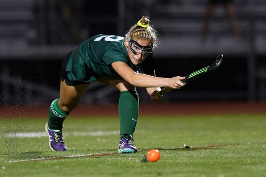 Rice's Lisa McNamara (2) hits the ball down the field during the field hockey game between the Rice Green Knights and the Burlington Seahorses at Buck Hard Field on Friday night September 28, 2018 in Burlington.
