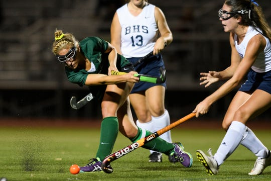Rice's Lisa McNamara (2) shoots the ball during the field hockey game between the Rice Green Knights and the Burlington Seahorses at Buck Hard Field on Friday night September 28, 2018 in Burlington.