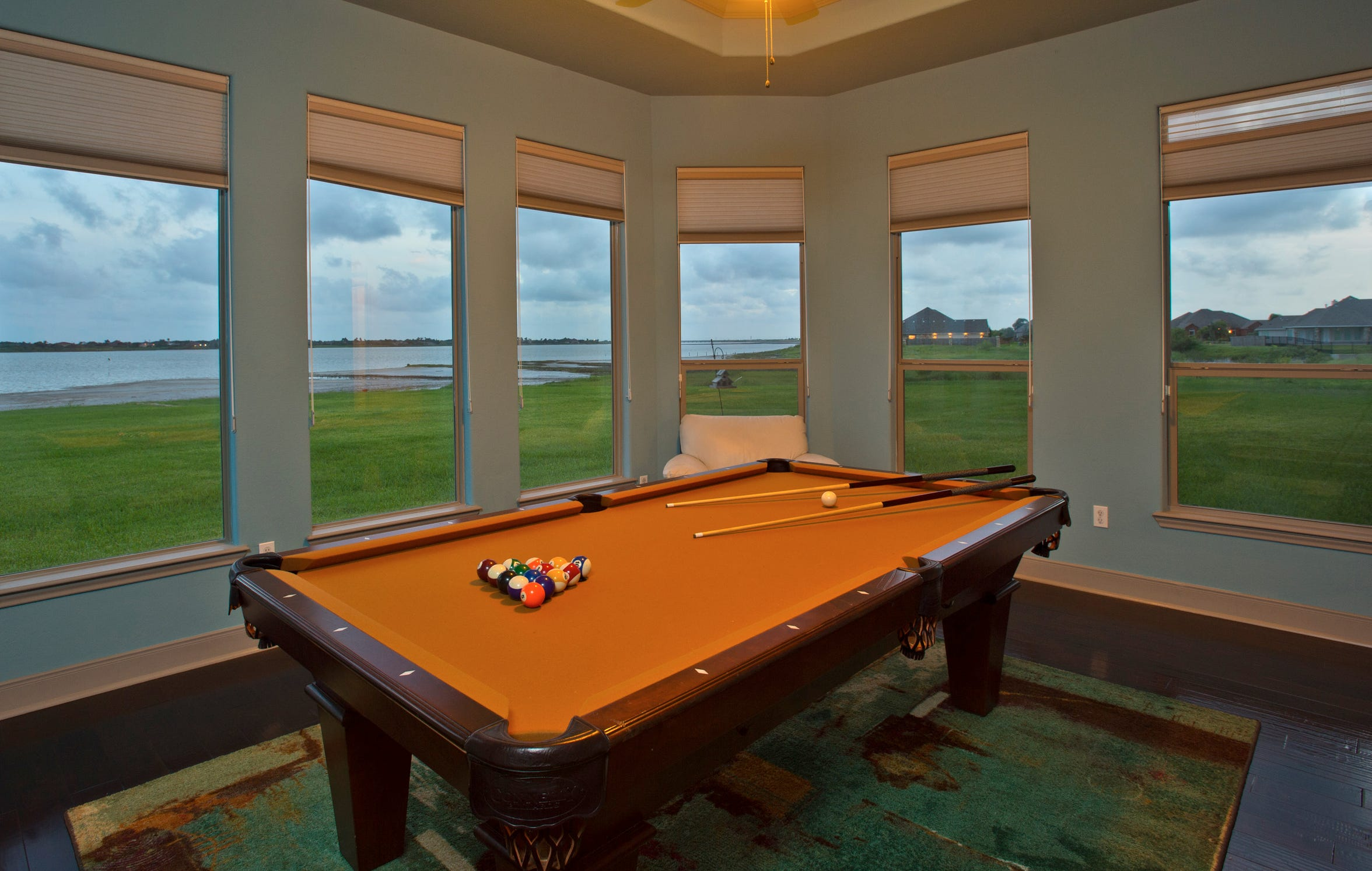 The game room takes in panoramic views of the acreage and Oso Bay.