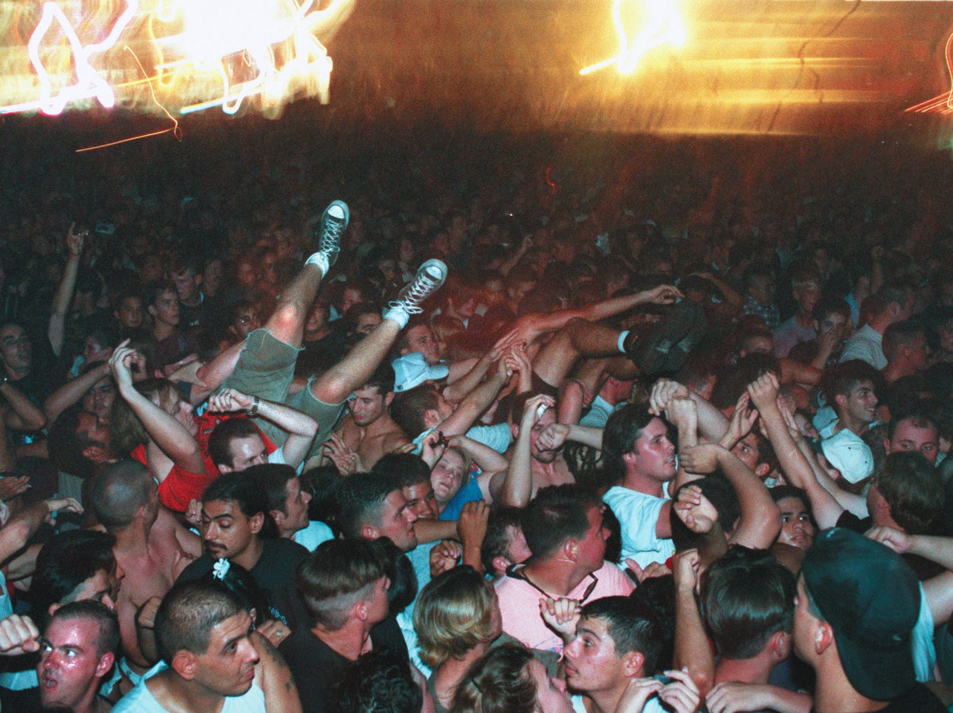 Concert goers are carried over the crowd at Texas Sky Festival Park in Corpus Christi during the Butthole Surfers' concert on July 6, 1996.