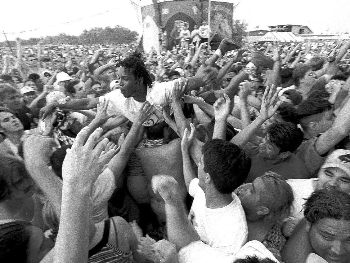 Van Damn, of the Lost Boyz, body surfs across the crowd during their performance at Lollapalooza at Texas Sky Festival Park in Corpus Christi on Aug. 3, 1997.