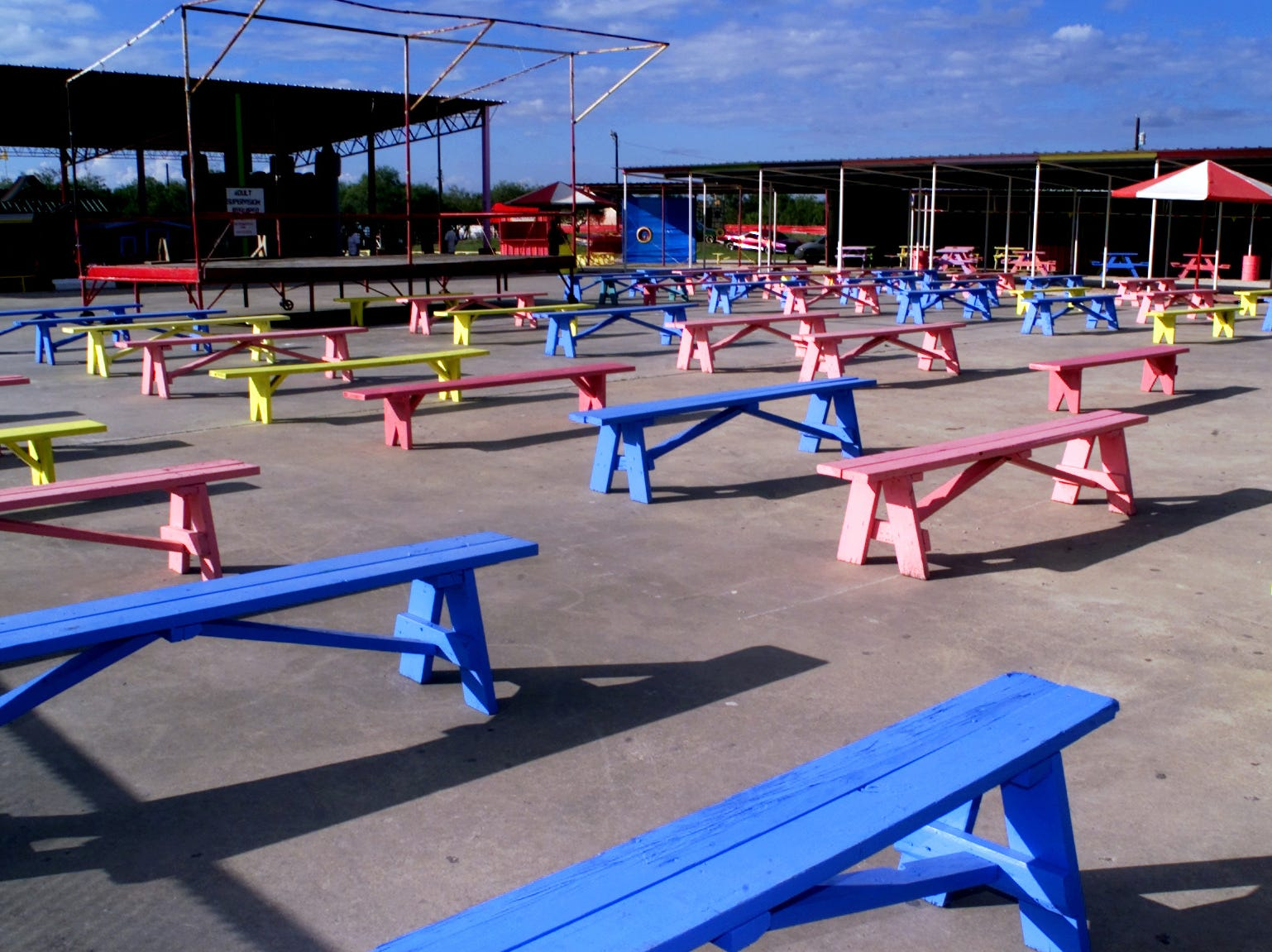 Multi-colored benches are seating in the performance area inside Texas Sky Festival Park on Jurica Road in October 2000. The owners began showincasing religious concerts only 1998.