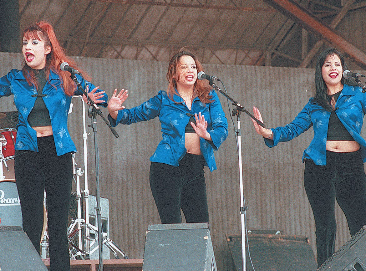 Hermanas Ortegon (Ortegon sisters)  from San Antonio;  Monica Ritchie, left;  Babette Marie, center;  and Melody Rene, right;   perform during the JamaicaFest at Texas Sky Festival Park in Corpus Christi on Nov. 16, 1997.  The two-day event featured some top known groups.