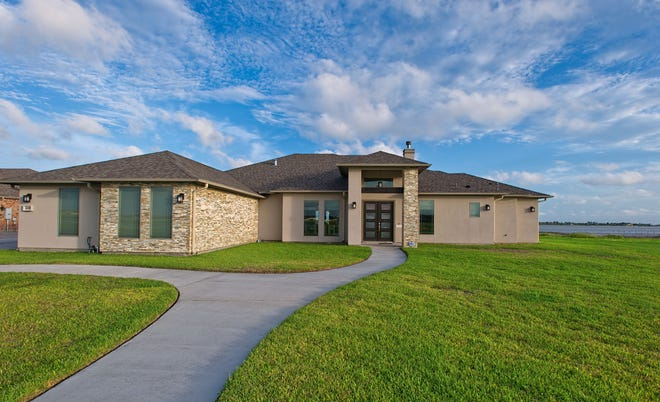 3001 N. Oso Pkwy sits on a nearly 2 acre lot on the shores of Oso Bay in Terra Mar subdivision.