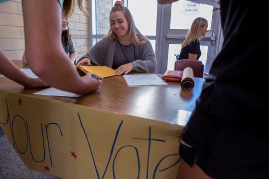 Ray High School students Isabel Ostos (from left), 17, Bailey Kasprzyk, 17. and Lillie Zuniga, 18, register students to vote at the school on Wednesday, October 3, 2018.