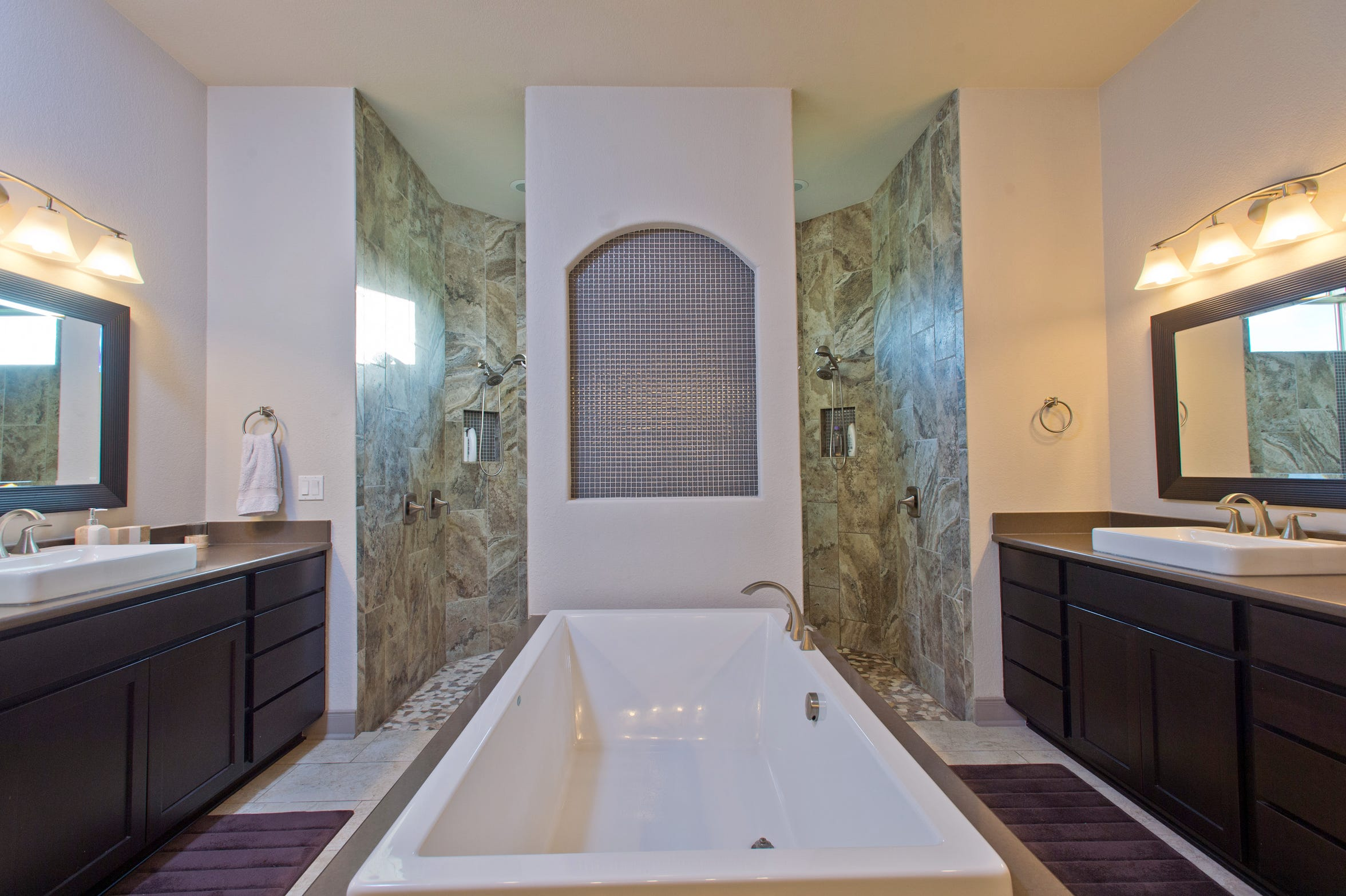 The luxurious master bath has walk-in shower, soaking tub, three vanity areas, and an oversized walk-in closet with built-ins