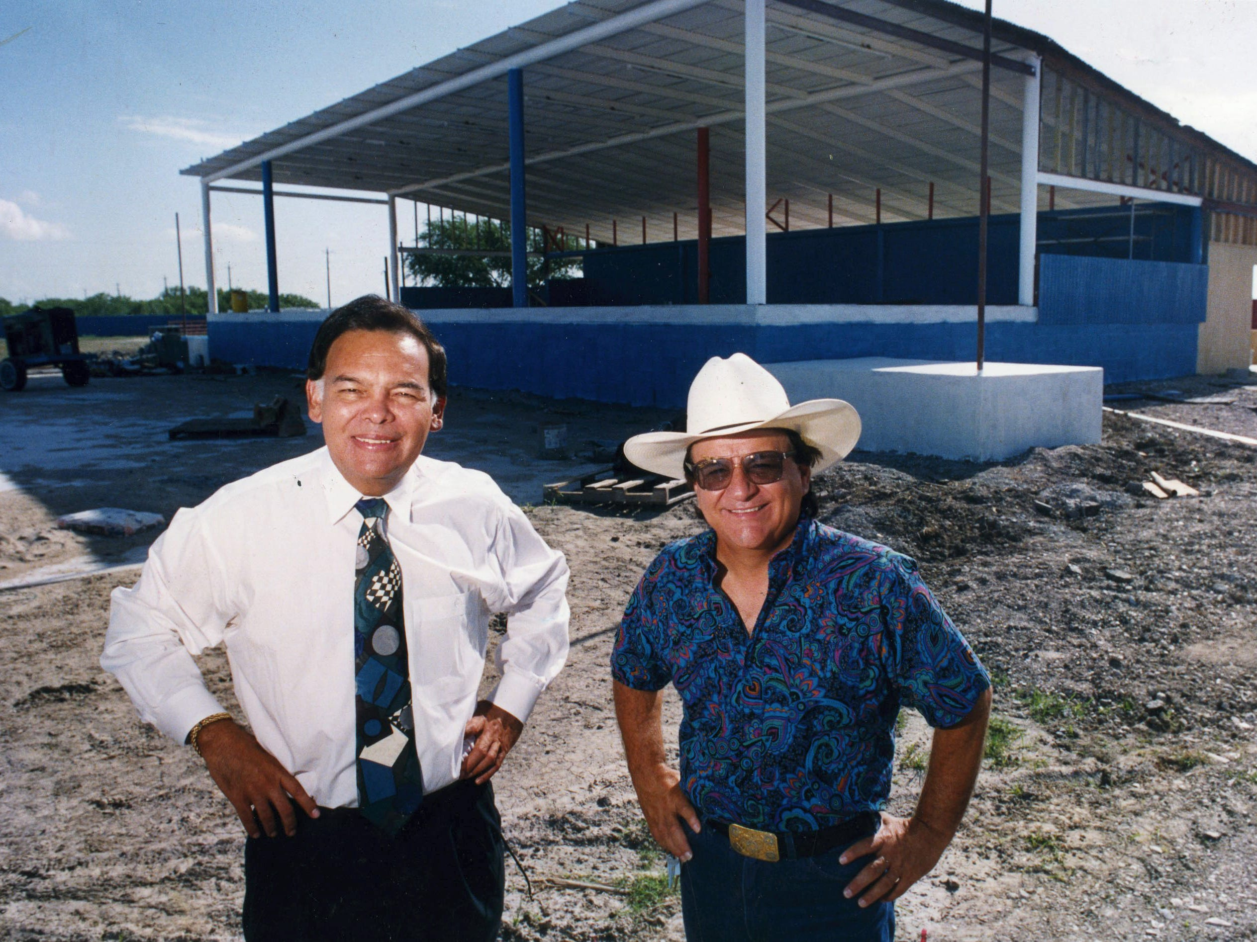 Johnny Canales (right) and Albert Huerta, owner and partner of JohnnyLand, stand in front of the stage area of the concert park being built off Saratoga in September 1993.