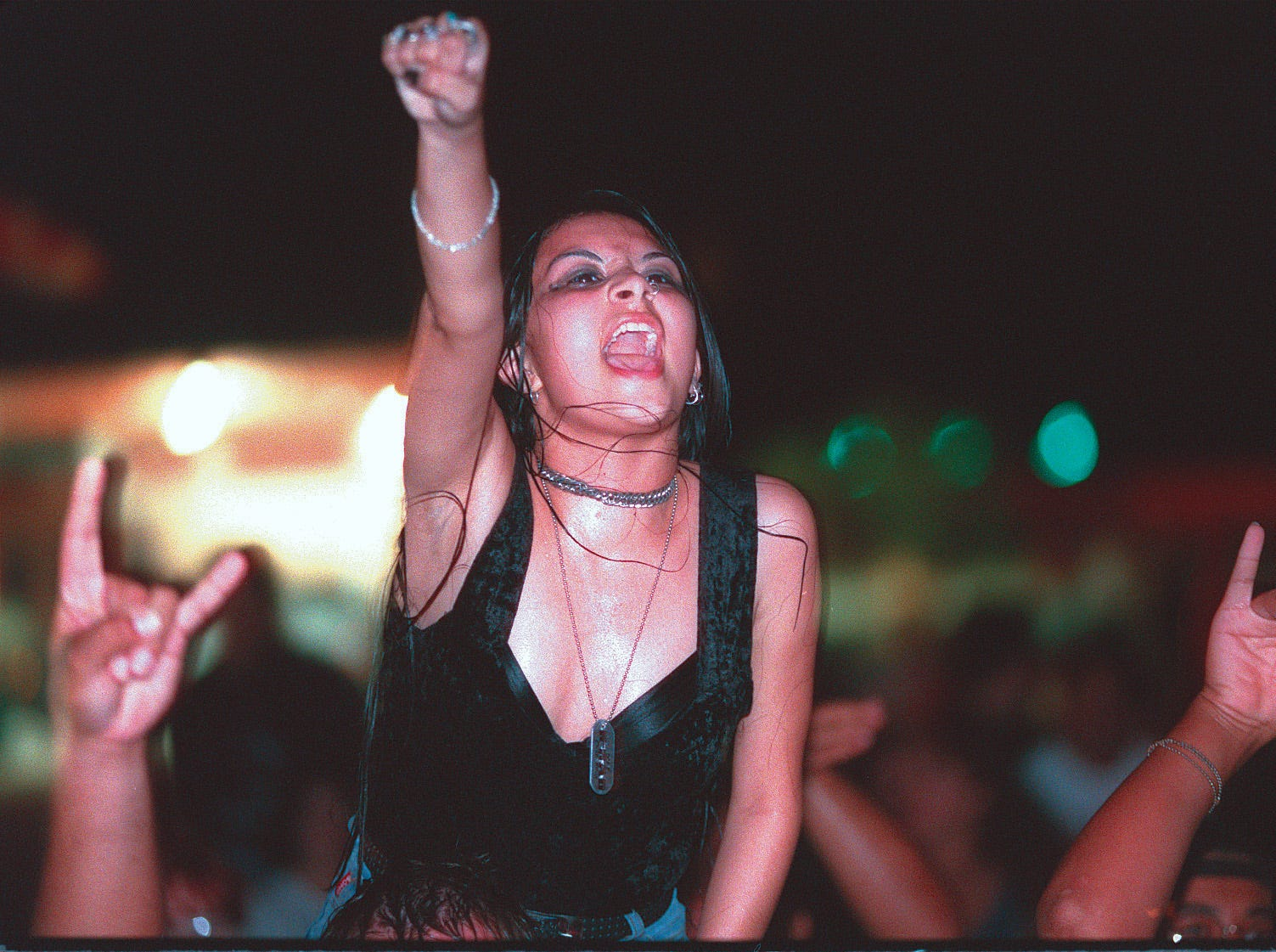 An excited fan cheers on Anthrax June 12, 1996 at Texas Sky Festival Park in Corpus Christi.