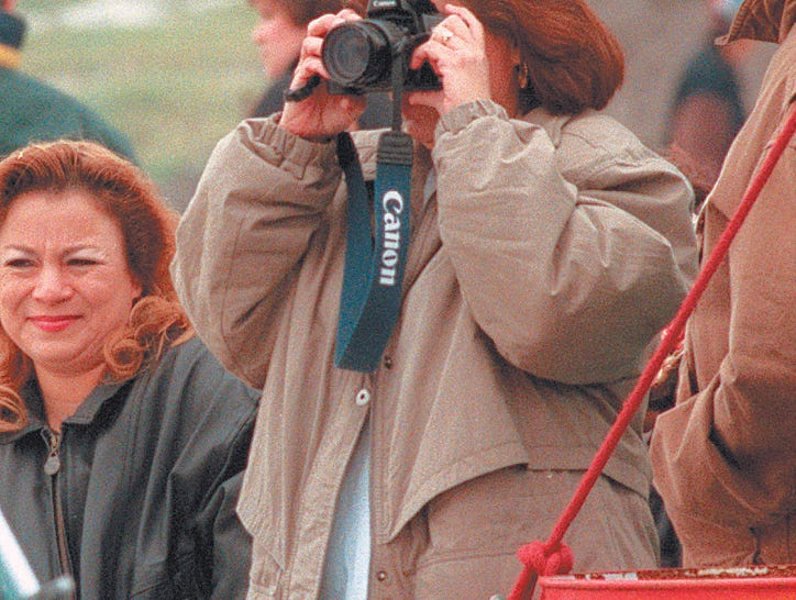 Esmeralda Carillo of San Diego takes photos of 'Xklusivo' a musical group performing at the JamaicaFest at Texas Sky Festival Park on Jurica Road in Corpus Christi on Nov. 16, 1997.