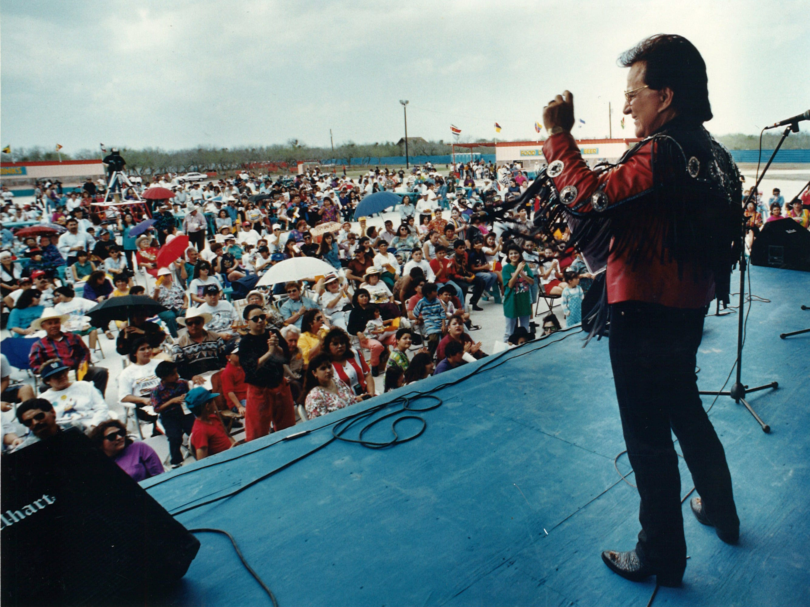 "Johnny Canales greets the crowd of thousands at the new outdoor concert arena known as Johnnyland on March 6, 1994. A ""sneak preview"" of the Johnny Canales International show was taped at the arena on County Road 37, Jurica Road, between Saratoga Blvd. and Old Brownsville Road just outside the Corpus Christi city limits."