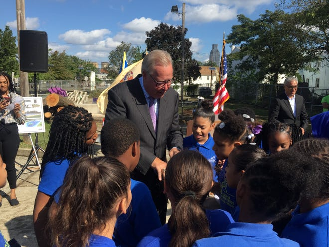 Former Eagles quarterback Ron Jaworski shows off his Super Bowl ring to children from KIPP Cooper Lanning School. Jaworski's foundation donated $100,000 towards rehabilitating a park at 4th and Clinton streets in Camden.