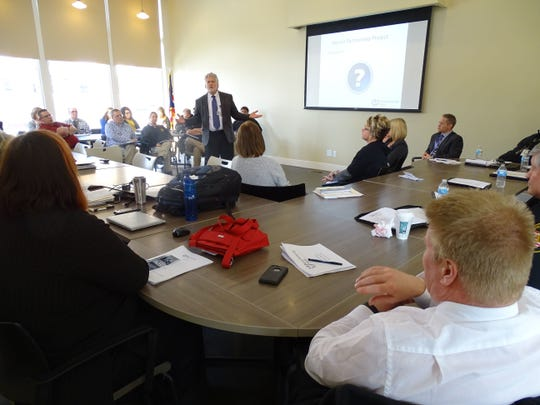 """Heroin Partnership Project Chair Dr. John Gabis addresses those gathered at the monthly partnership meeting in February 2016. The organization re-named itself """"Hope Partnership Project"""" at the September 2018 monthly meeting."""