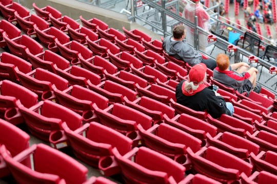 Cincinnati Reds fans watch the game in the fourth inning during the National League baseball game between the Atlanta Braves and the Cincinnati Reds, Tuesday, April 24, 2018, at Great American Ball Park in Cincinnati.