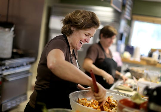 An artists group is sponsoring a fundraiser for La Soupe Cincinnati in February. Suzy DeYoung, seen here, is founder of the organization that partners with grocery stores, farmers and chefs to collect good food that otherwise would be thrown out and distributes it to hungry people in Greater Cincinnati.