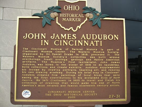 This Ohio historic marker in front of the Cincinnati Museum Center tells of John James Audubon's time in Cincinnati working with the Western Museum Society.