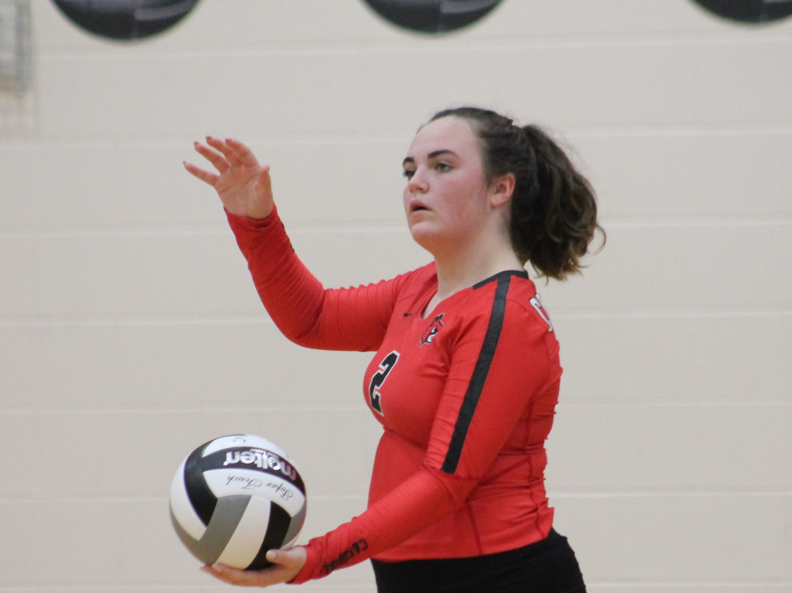 Colerain defensive specialist Sydney Hampton takes a turn serving