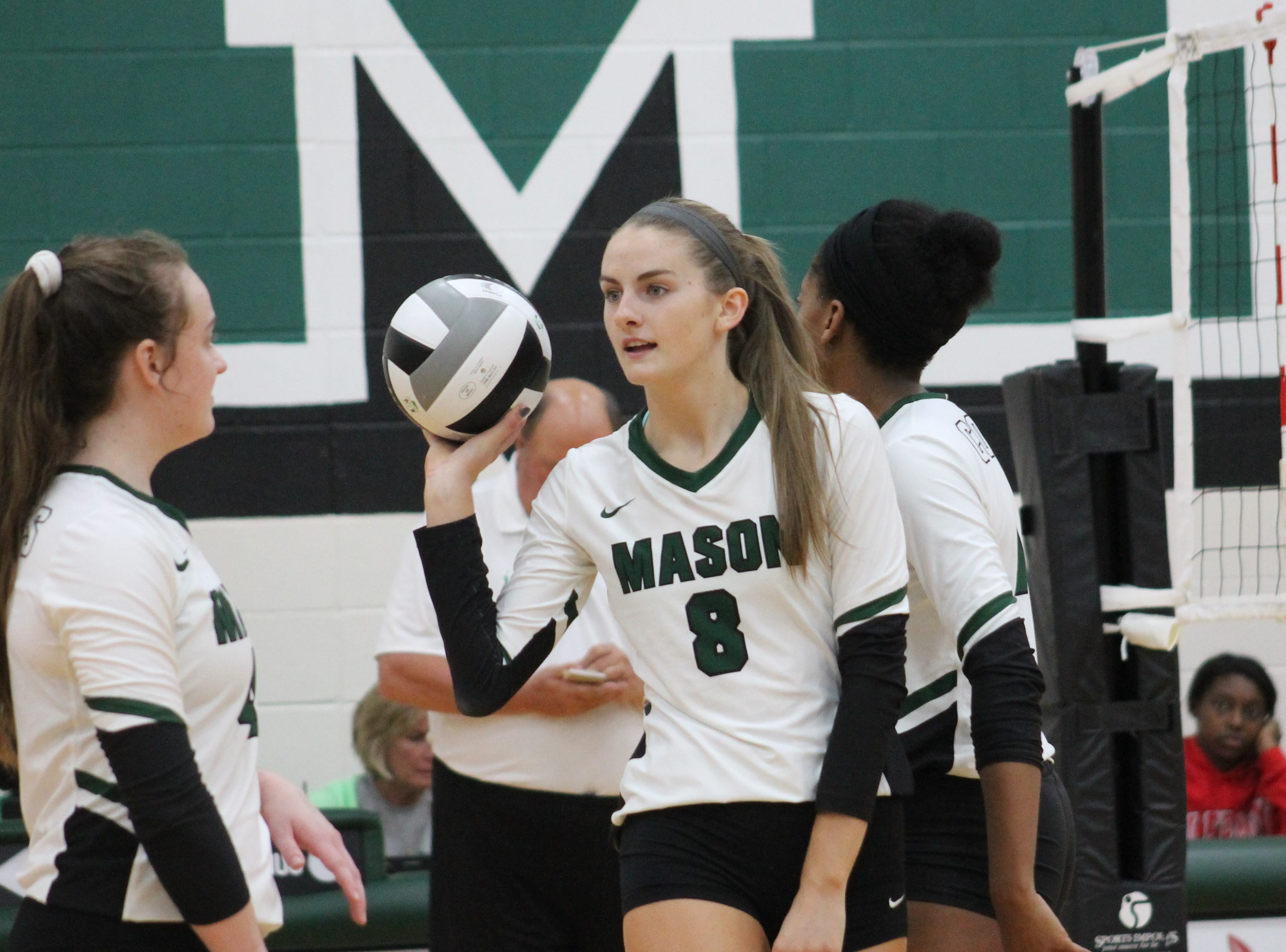 Mason senior hitter Maggie King returns the ball to the server after a point