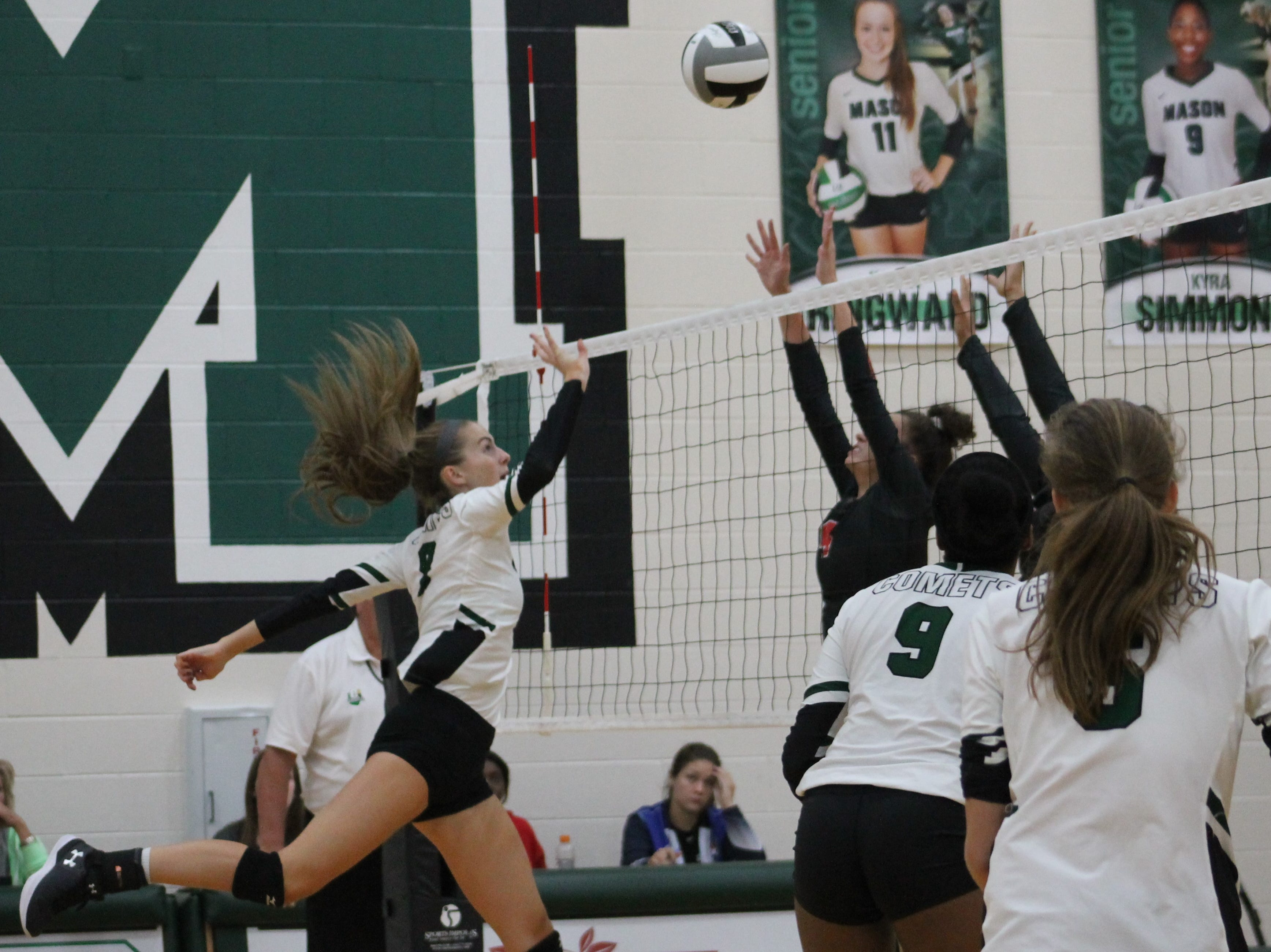 Maggie King goes up for the point for Mason