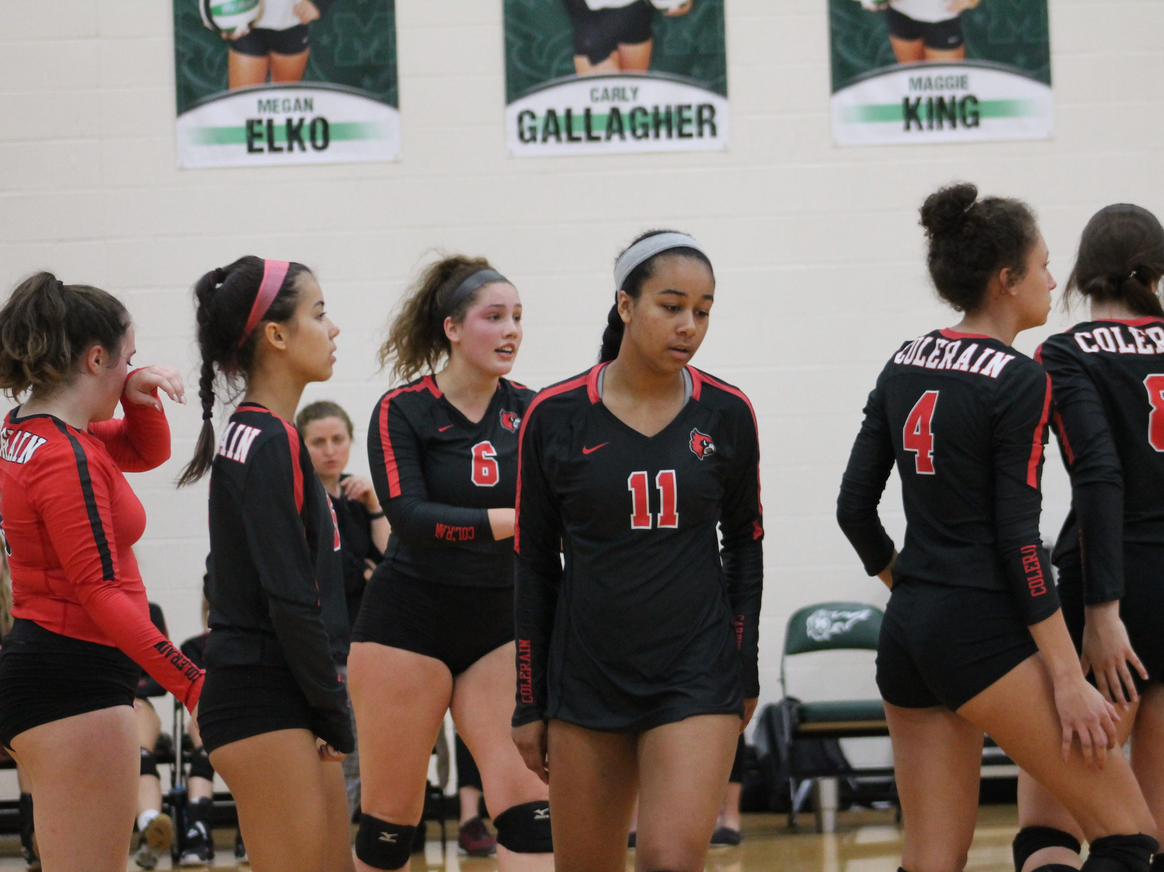 Taiah Pewett (11) and Colerain regroup after a point at Mason Tuesday Oct. 2