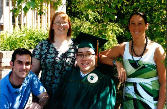 Neil Kelly at his graduation from Sycamore High School, pictured with his siblings, Greg, Beth and Jennie