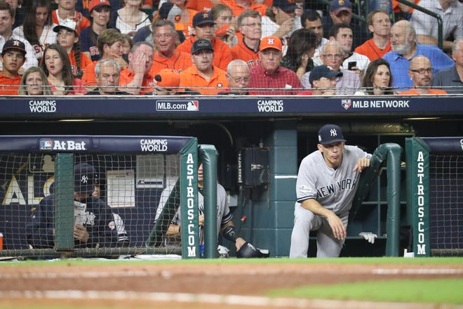 Oct 21, 2017; Houston, TX, USA; New York Yankees manager Joe Girardi (28) looks on from the dugout in the sixth inning against the Houston Astros during game seven of the 2017 ALCS playoff baseball series at Minute Maid Park. Mandatory Credit: Thomas B. Shea-USA TODAY Sports
