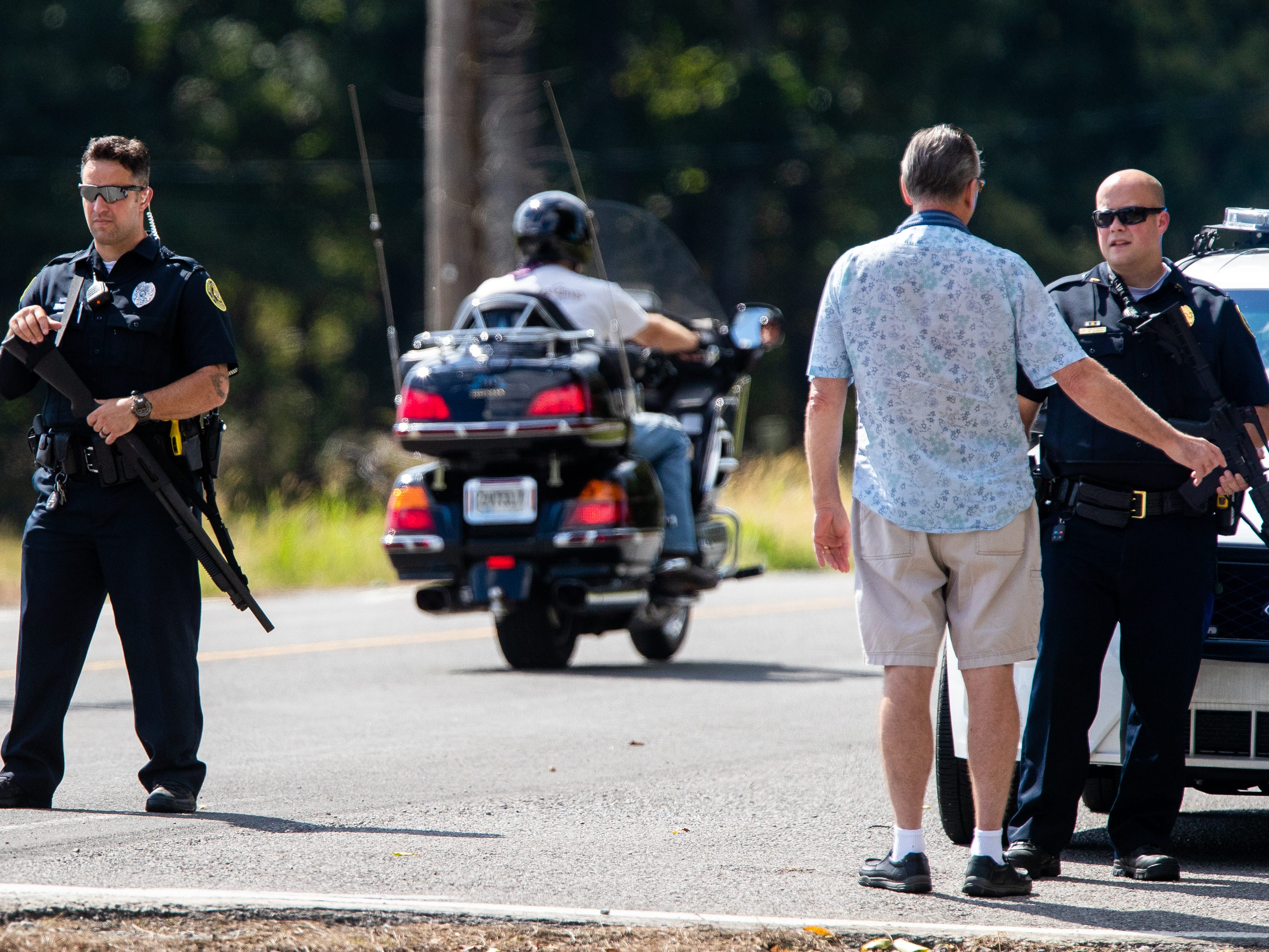 Police guard a roadblock on Lylewood Road at Cooper Creek and York Landing Roads during the search for Kirby Wallace on Wednesday, Oct. 3, 2018, in Woodlawn, Tenn.