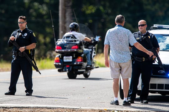 Police guard a roadblock on Lylewood Road at Cooper Creek and York Landing Roads during the search for Kirby Wallace on Wednesday in Woodlawn.