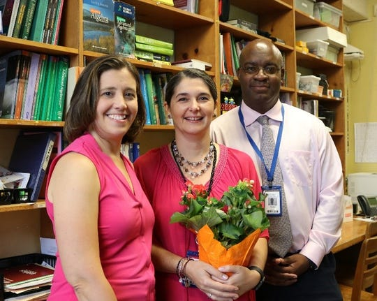 Westfield Public School District K-12 Supervisor of Mathematics Elizabeth Delasandro (left) and Westfield High School Principal Dr. Derrick Nelson congratulate WHS math teacher Zorana Culjak for receiving the University of Chicago Outstanding Educator Award.