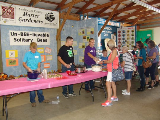 Fair-goers sample dishes during the Tasting Smorgasbord at the Coshocton County Fair.