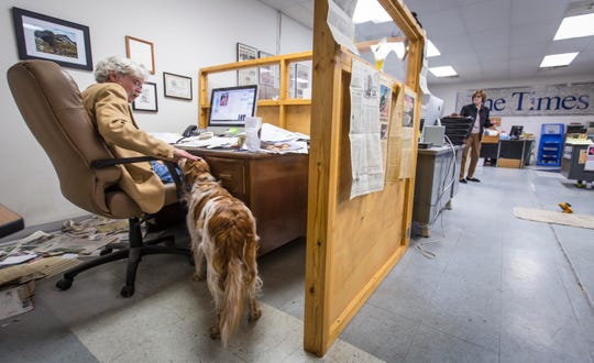 Art Cullen pats the head of his dog, Peach, while on deadline for The Storm Lake Times on Tuesday, Oct. 2, 2018.