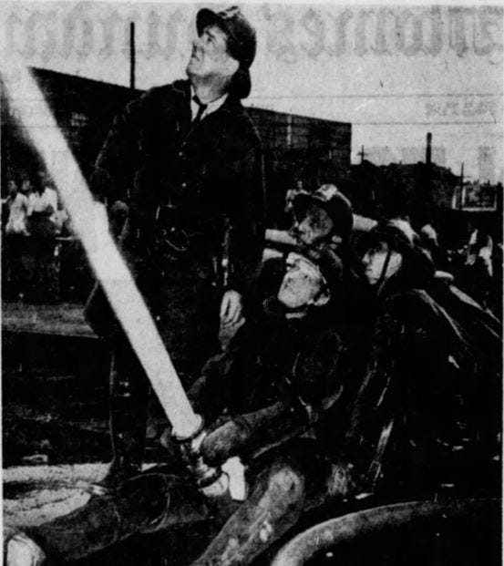 From 1949: Four Des Moines firemen battle the fire that destroyed the Des Moines Coliseum.
