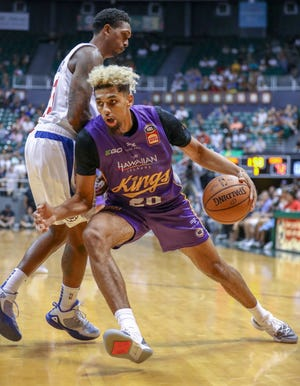 Brian Bowen II of the Sydney Kings drives baseline around Clippers guard Lou Williams on Sept. 30 in Honolulu, Hawaii.