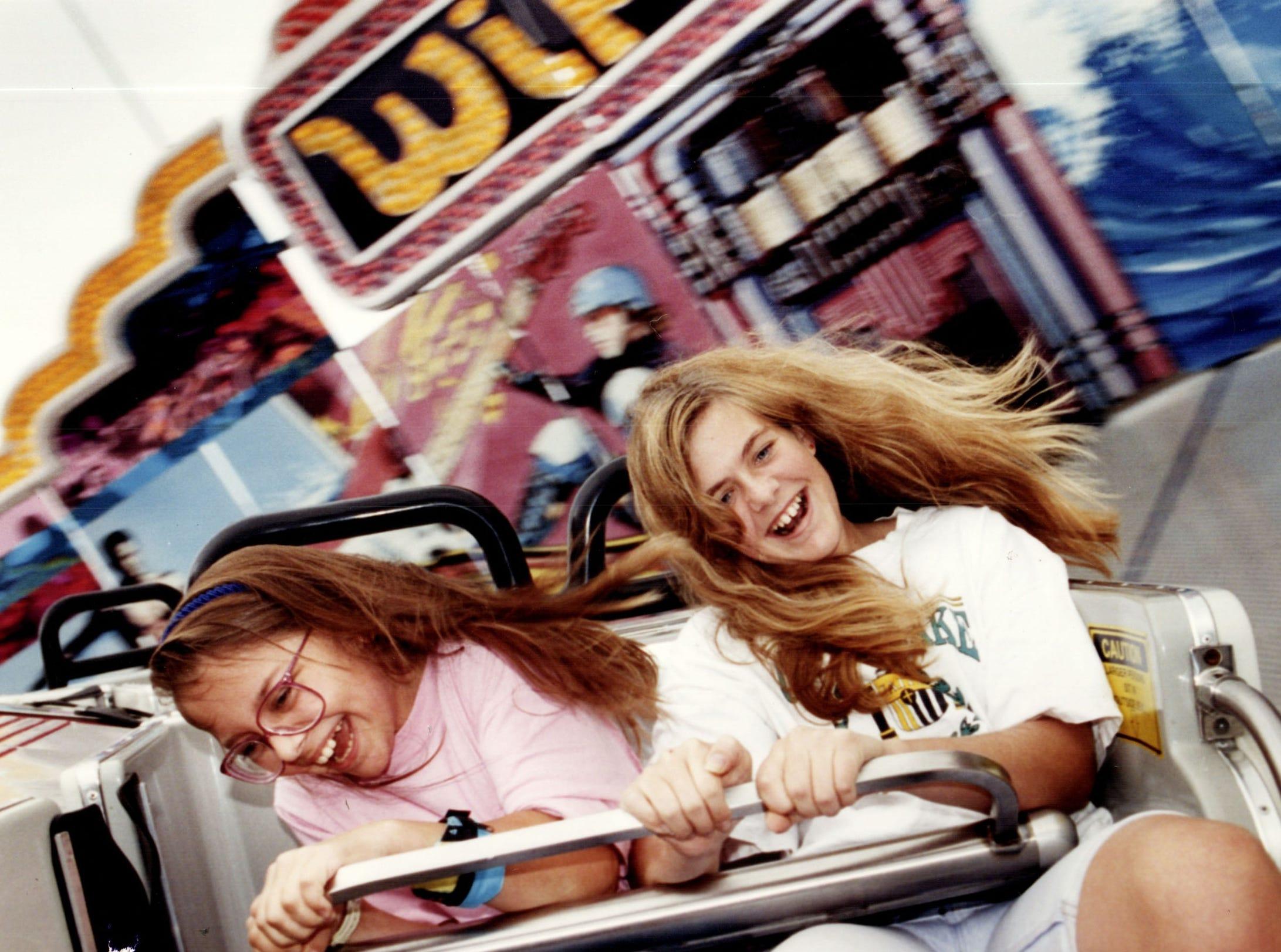 Two girls enjoy a ride on Boblo Island in 1993.