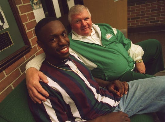Mill Coleman and his former college coach, Michigan State's George Perles.