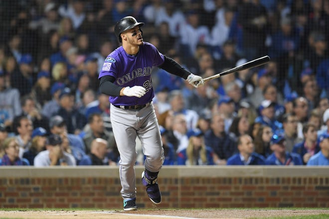 Colorado Rockies' Nolan Arenado hits a sacrifice fly ball in the first inning against the Chicago Cubs during the NL Wild Card Game at Wrigley Field on Oct. 2, 2018 in Chicago.