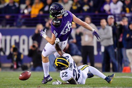 David Long knocks the ball away from Northwestern receiver Bennett Skowronek on Saturday.