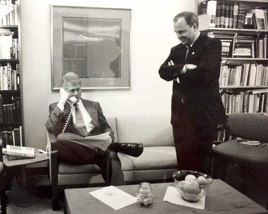President Bill Clinton, left,  and Mack McLarty confer at the White House in March 1995. In 1995, McLarty served as counselor to the President.