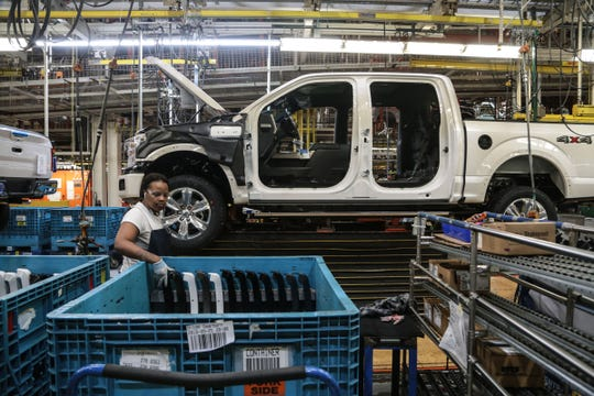 Workers on the assembly line for the Ford F-150 trucks at the Ford Rouge Plant in Dearborn on Thursday, September 27, 2018.