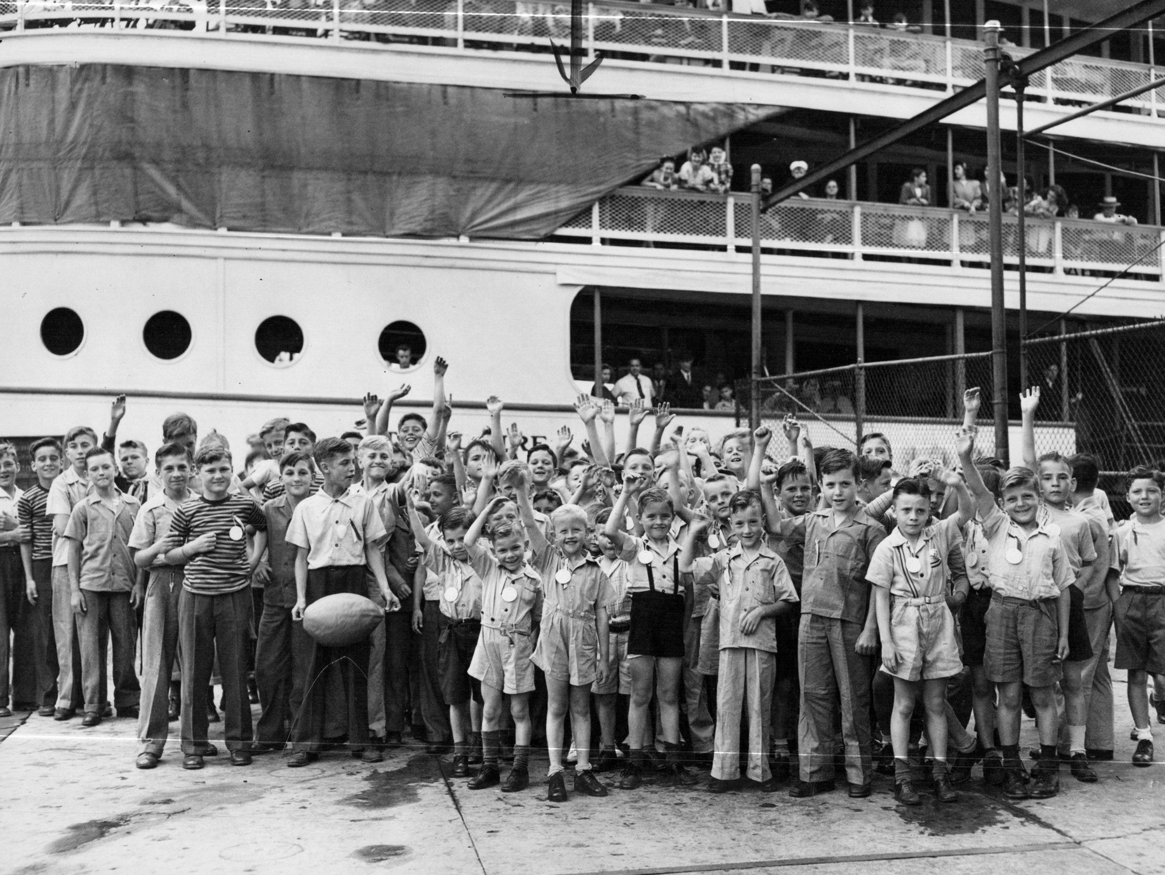 Orphans of St. Francis Society before they departed Sunday for an all day outing at Boblo in 1947. The event was the annual treat of Monaghan Council, No. 6290, Knights of Columbus.