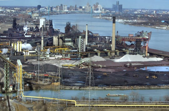 The Rouge River, bottom, flows past the industrial Zug Island, middle, with the Detroit River, Ambassador Bridge and the city skyline rising up at back on Monday March 15, 2004.